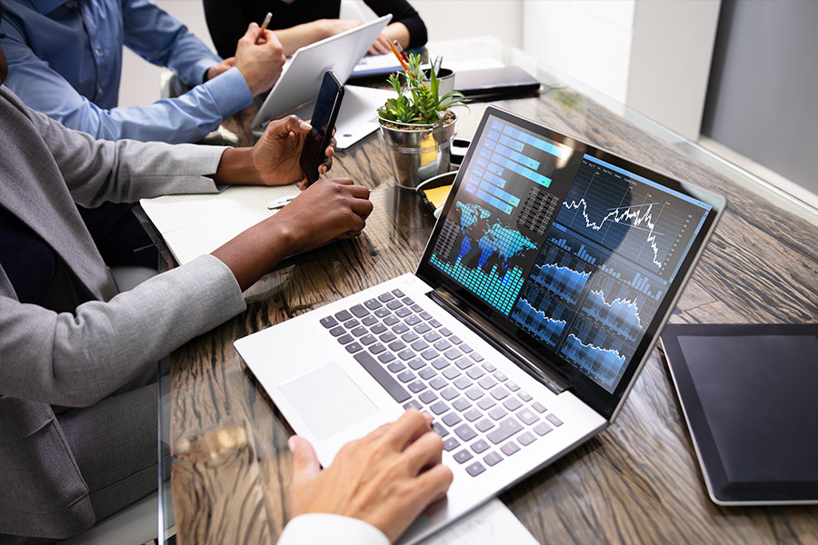 Cybersecurity experts reviewing laptop of data