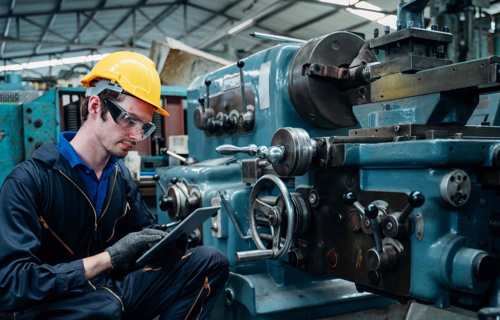 worker performing maintenance at facility
